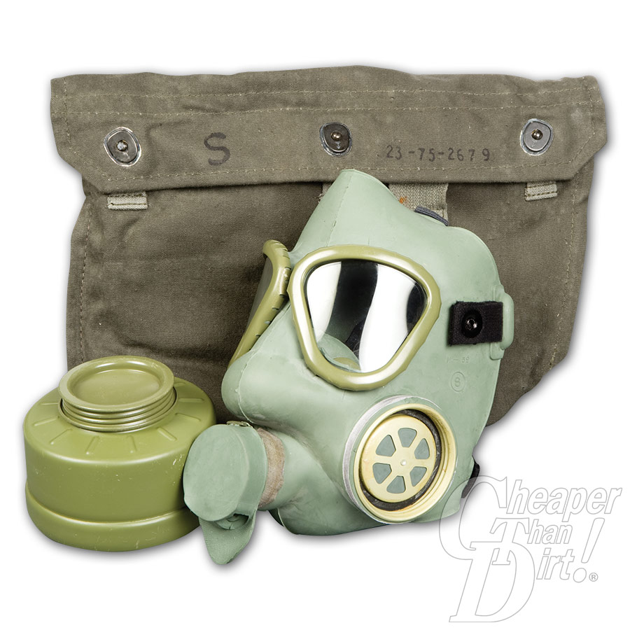 Picture shows a green rubber gas mask with filter and OD green canvas carrying bag.