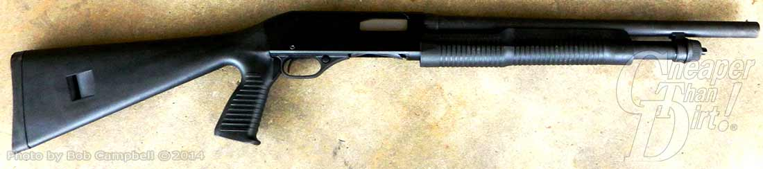Black Stevens 320 Shotgun, barrel pointed to the right on a tan mottled background.