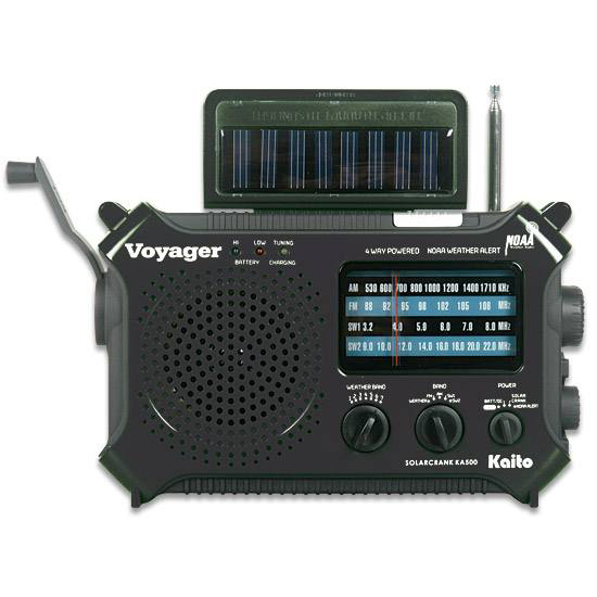 Picture shows a black emergency radio with a crank power button and pop up spot light.