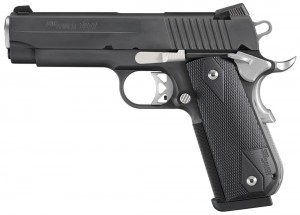 Black SIG 1911, barrel pointed to the left, on a white background.