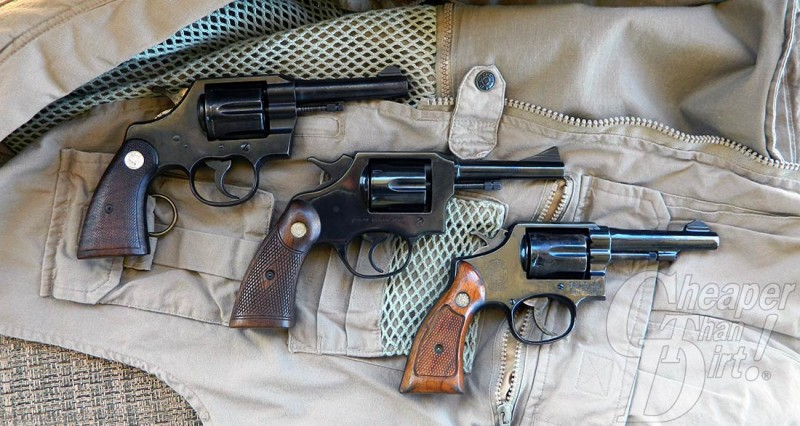 3 different revolvers against a beige background