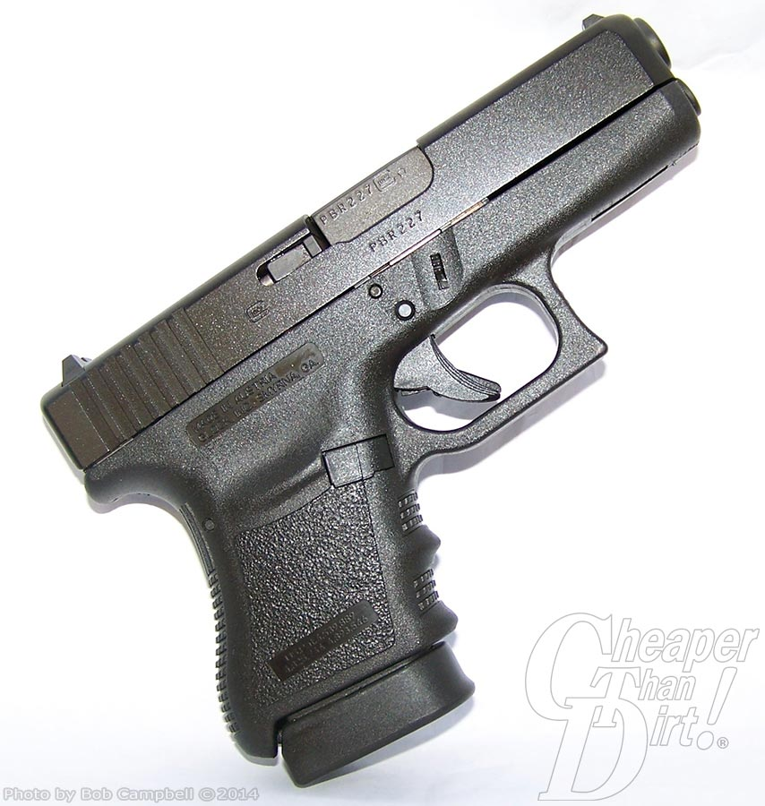 Black Glock revolver, barrel pointed up and to the right on a white-to-gray background