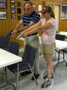 Bethany Tedder is demonstrating the proper handgun grip.