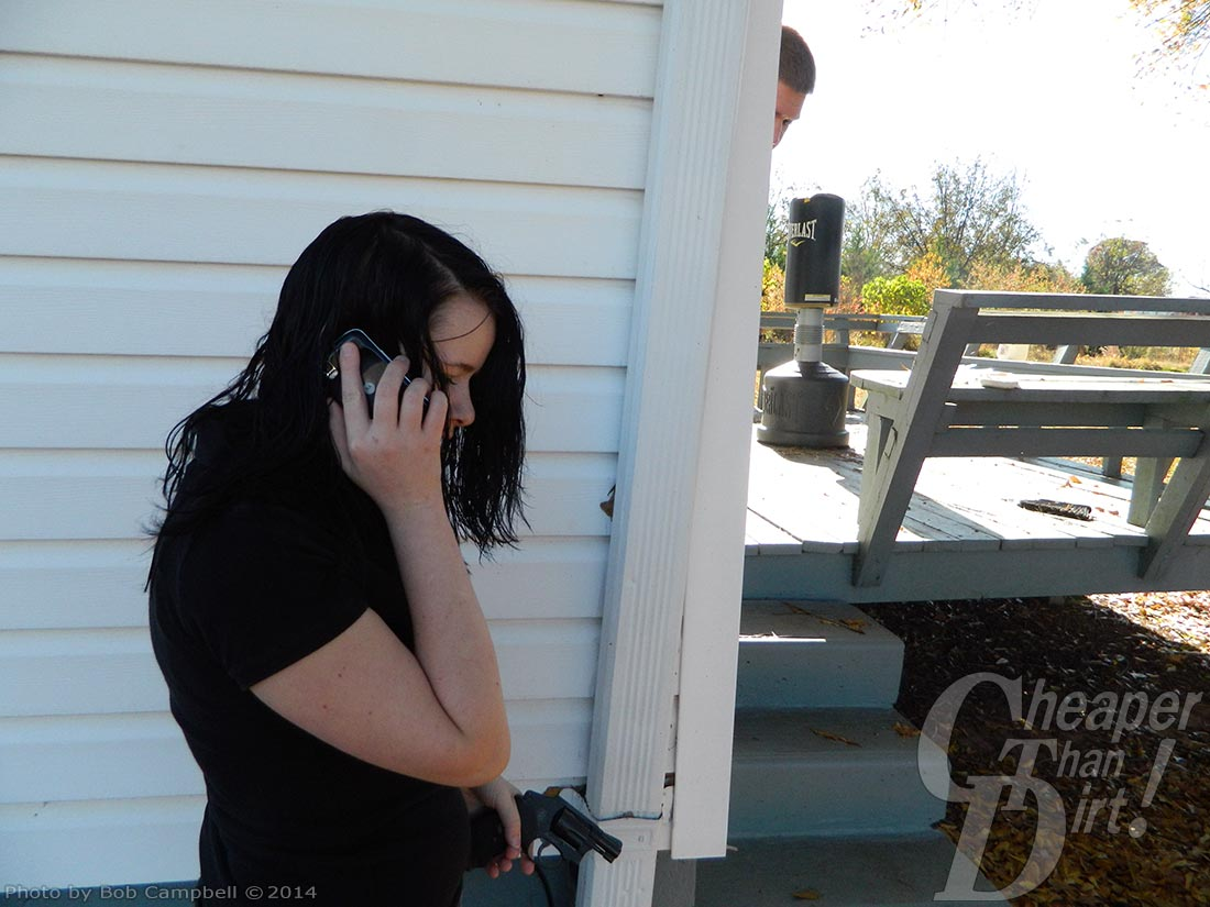 A young woman in a dark t-shirt calls 911