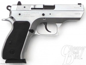 Black handled, silver barreled compact 9mm, barrel pointed to the right on a white-to-light gray background