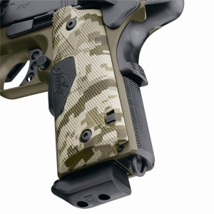 Camo handled handgun with the focus on switch that shuts the unit down, on a white background