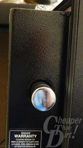 Picture of a black gun safe with a silver bolt