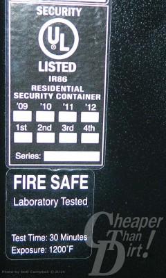 Blue label safety label on a black gun safe