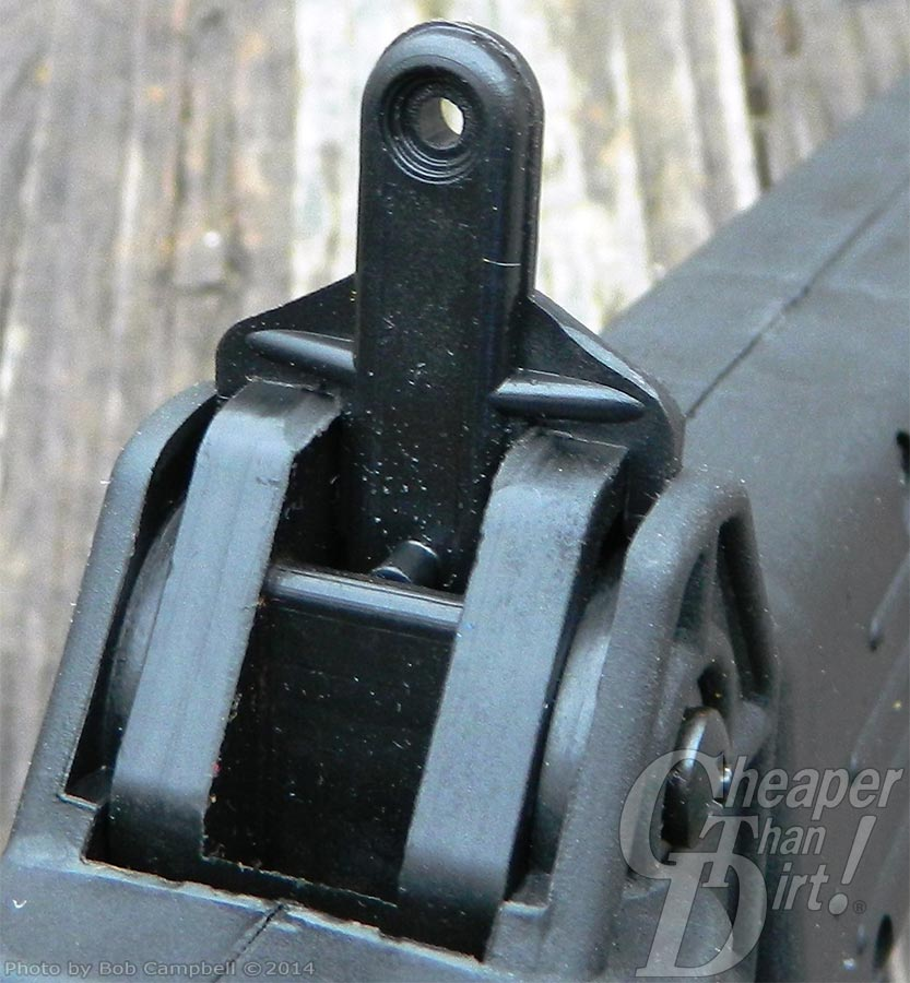 Focus on the rear sight of the Kel-Tec carbine, barrel pointed away from you