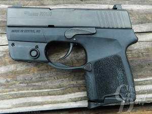 A black SIG P290 with a focus on the trigger action and grip.