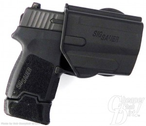Black SIG P250 In supplied plastic holster on a white background.