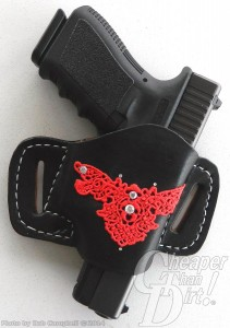 Black handled Glock 19 9mm in a black holster with a red decoration on a light gray background