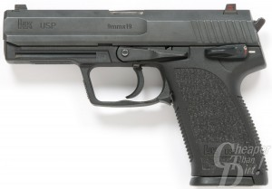 Black compact 9mm, barrel pointed to the left on a white background