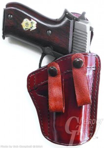 Dark brown handled SIG P 220 in a rich medium brown Don Hume IWB holster
