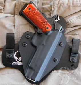 Medium wood-grain handled Smith and Wesson E class 1911 in a black holster