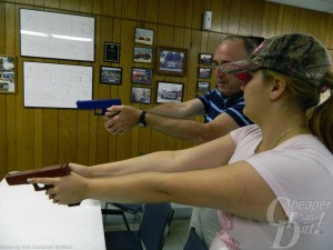 Young lady in white t-shirt and camo cap practices the right grip