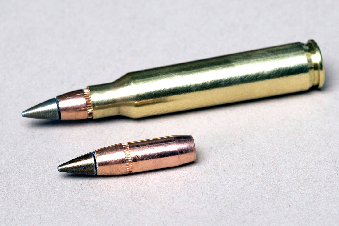 Picture shows a rifle cartridge on top and the bullet under it.