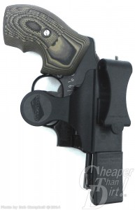 Black .38 in a black holster on a white background