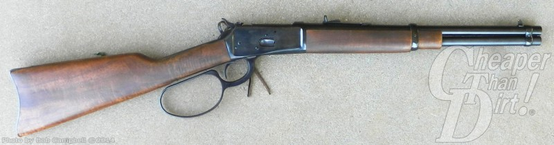 Rossi 92 with barrel pointed to the right on a gray background
