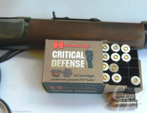 Rossi 92 and a box of Hornaday ammunition on a light blue background