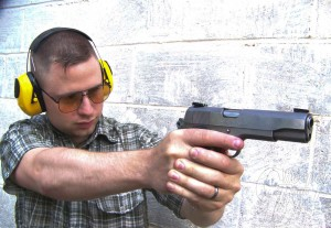 Shooter at indoor range shooting the Colt Delta Elite