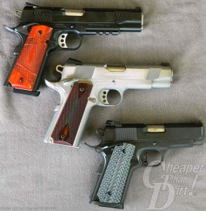 3 handguns, starting from the top: a brown handled black barreled Government Model, a brown handled silver barreld Commander and an all black Officer's Model 1911 on a gray background, barrels pointed to the right.