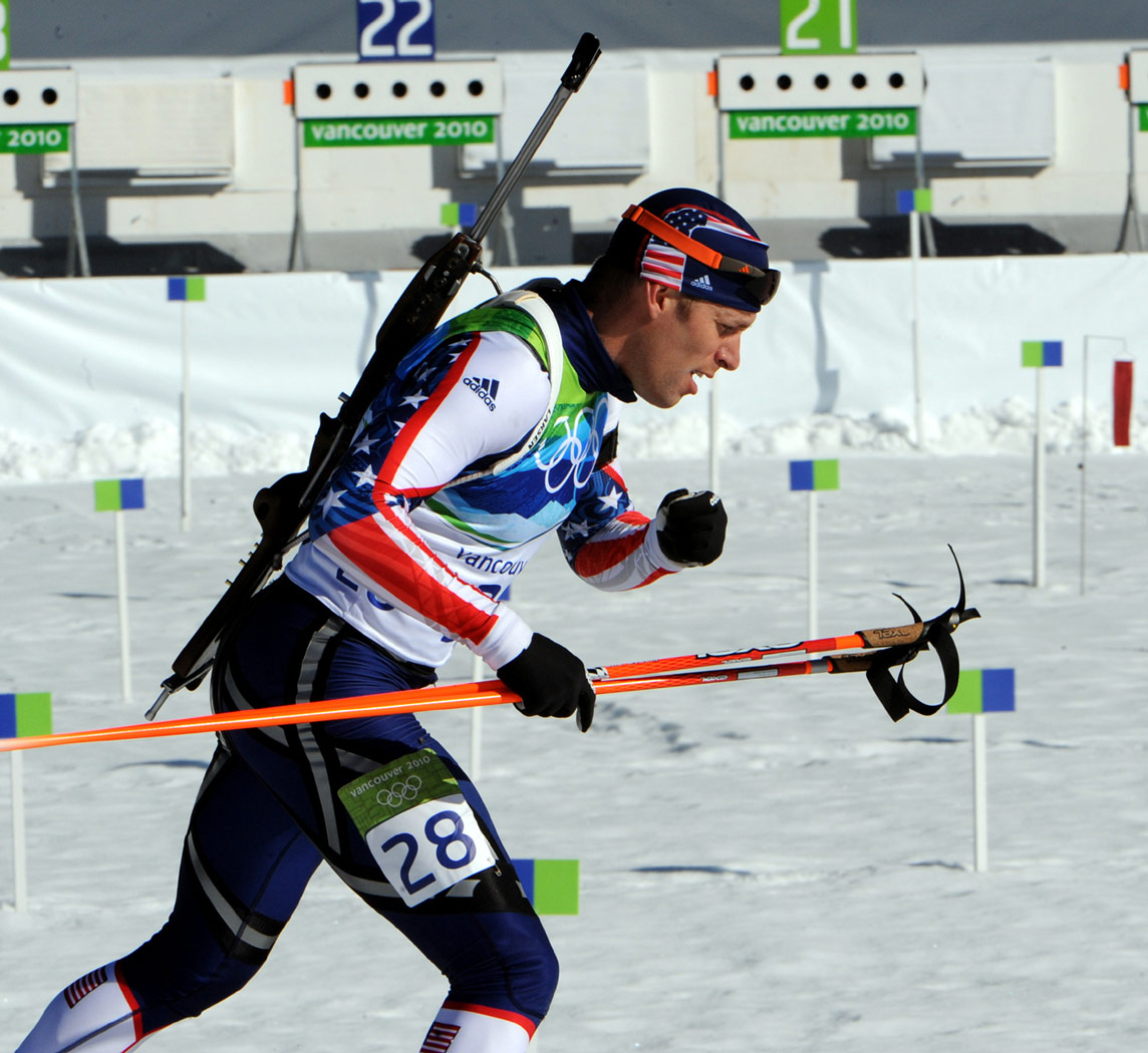 Biathlete with skis and rifle
