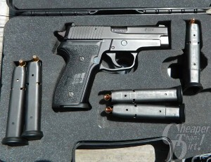 Black SIG P228 9mm in case with cartridges