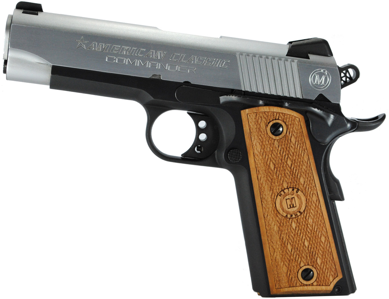 Picture shows a silve and black duotone Commander-sized 1911 handgun with wood checkered grips.