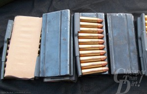 Multiple open boxes of .30 ammo on a dark gray background
