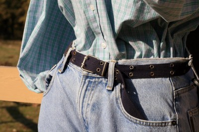 Pair of light blue jeans with a focus on the belt, which can be used in many ways to survive in an emergency.