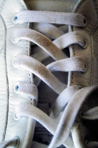 Pair of white tennis shoes with white shoelaces