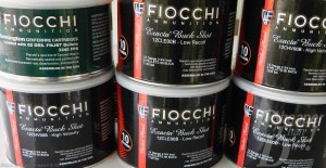 6 black cans of Fiocchi Canned heat with white lettering and a red stripe.