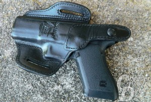 Black GLOCK 21 in a black Don Hume thumbbreak holster, barrel pointed to the left