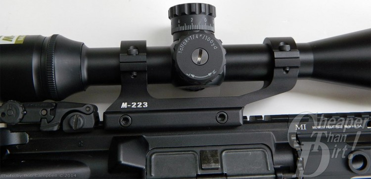 Black Nikon M223 riflescope showing adjustments on a light gray background