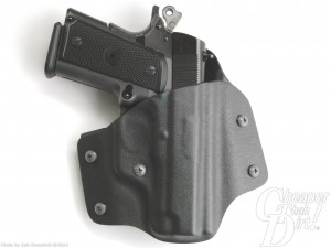 Black P12 in a Black OWB holster, barrel pointed downward on a white background