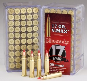 Open box of .17 HMR ammo with 5 cartridges in front of the box plus a closed box with a red label and white-and-black lettering on a gray background