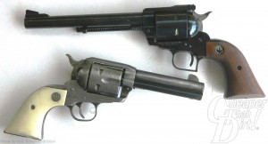 Two revolvers, the black barreled Super Blackhawk on the top and white-handled single action Ruger on the bottom on a white background