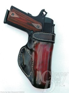 Brown and black Avenger type high ride holster with 1911