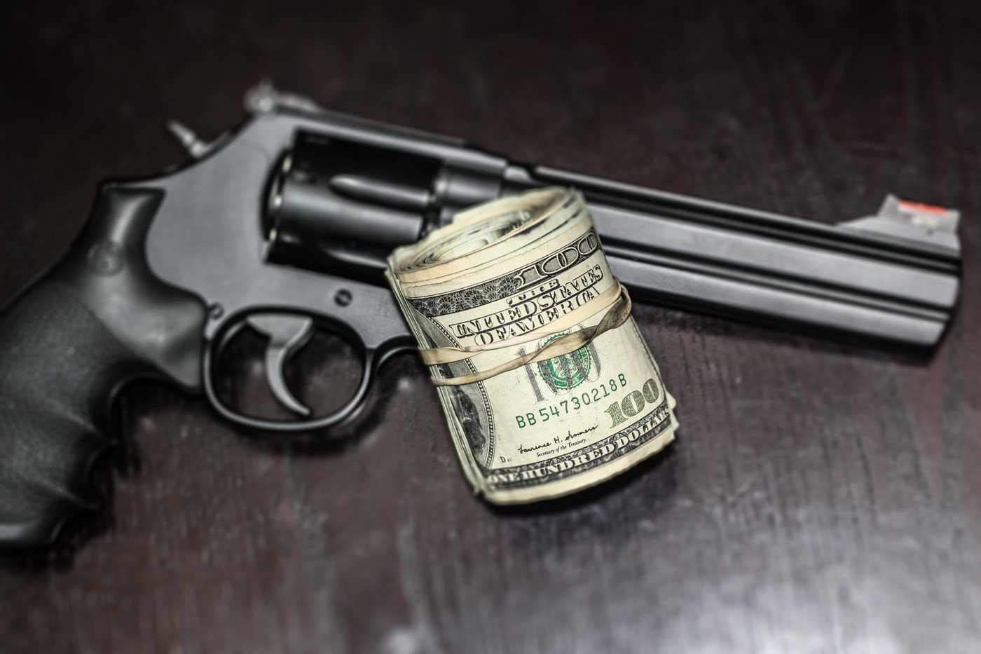 Smith and Wesson .357 Magnum and roll of money
