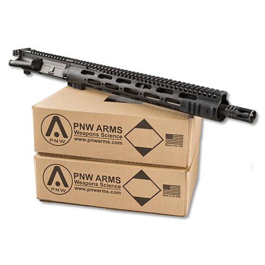 Picture shows a black upper receiver for an AR-15 sitting on top of two cases of ammunition.
