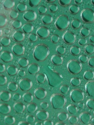 Aqua colored background with water droplets