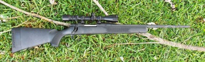 Dark Charcoal Mossberg ATR lying on green grass