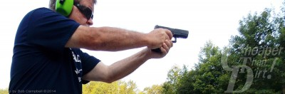 Gray-haired man with GLOCK 19 pistol in ready position.
