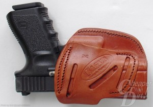 Medium brown leather holster with black-handled GLOCK 19
