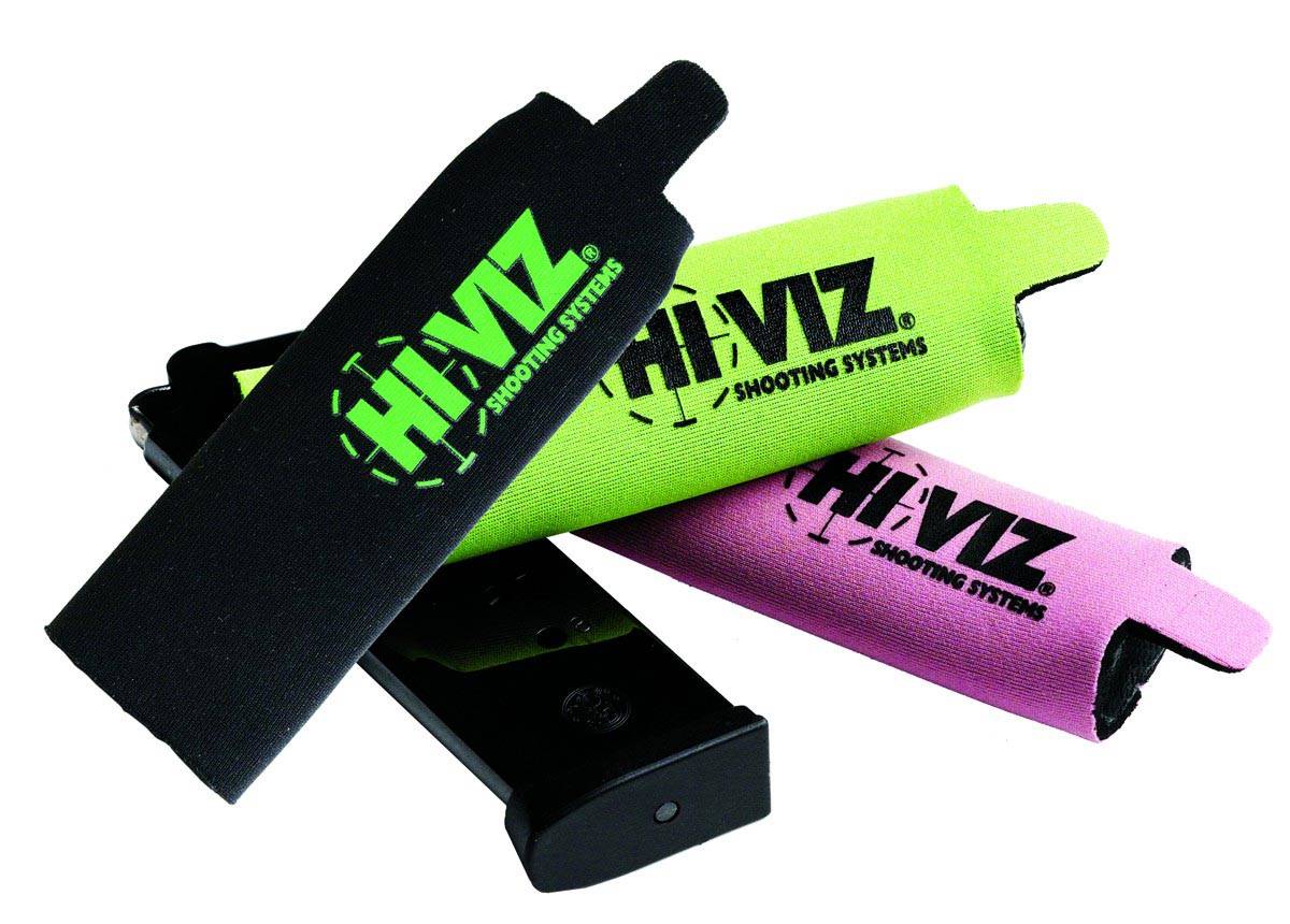 image shows three neoprene magazine covers in black, green, and pink