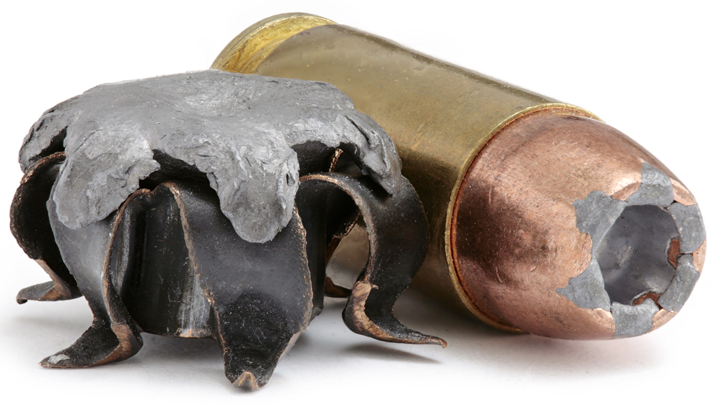 Picture shows a .40 S&W round next to a hollow point bullet already shot.