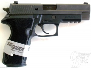 Black SIG P227 barrel pointed right on white background