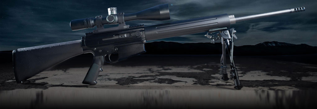 Picture shows a black AR-15 style rifle in front of a cloudy sky background.