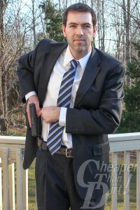 Jason Hanson with concealed carry in a suit and tie